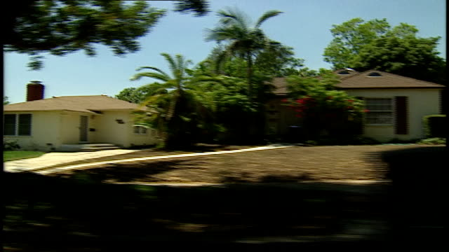 pov of driving through burbank california homes - burbank stock-videos und b-roll-filmmaterial