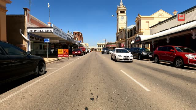 driving through busy country town main street on sunny day, rural australia - rural scene stock videos & royalty-free footage