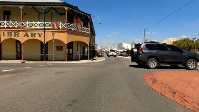 driving through busy country town main street on sunny day, rural australia - town stock videos & royalty-free footage