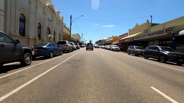 stockvideo's en b-roll-footage met driving through busy country town main street on sunny day, rural australia - sunny