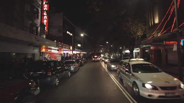 ws pov driving through busy king's cross / sydney, new south wales, australia - nightlife stock videos & royalty-free footage