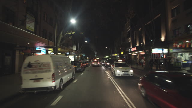 WS POV Driving through busy King's Cross / Sydney, New South Wales, Australia