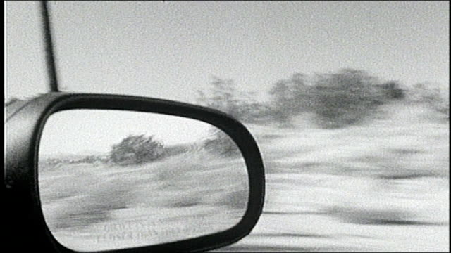 Driving Through California Desert and Seeing Side Mirror