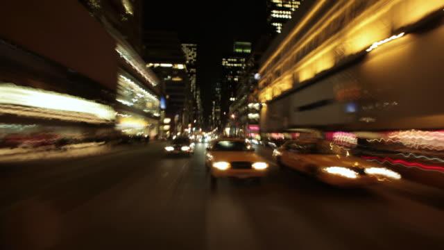 vídeos de stock e filmes b-roll de ms t/l pov driving through city at night / new york, united states - traffic time lapse