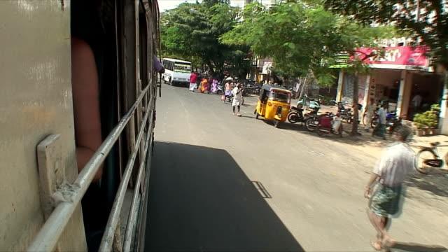 ms pov driving through city street, pondicherry, india - bus stock videos & royalty-free footage