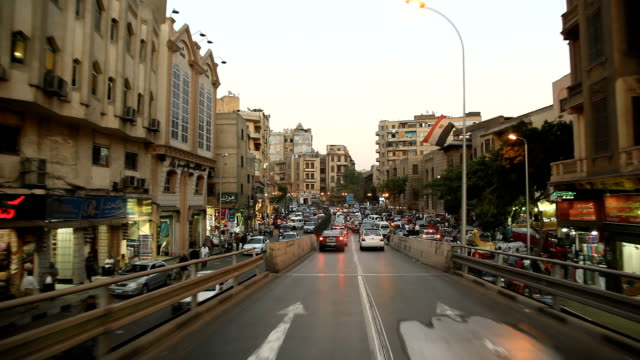 POV Driving through city Streets into traffic jam/ Cairo/ Egypt