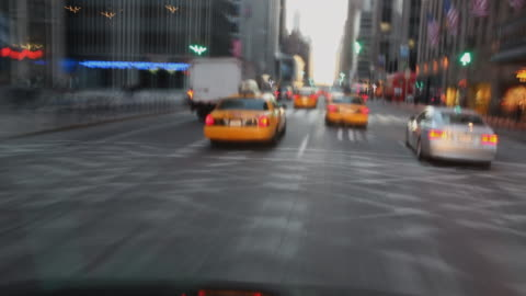 t/l pov driving through city traffic, new york city, new york state, usa - taxi stock videos & royalty-free footage