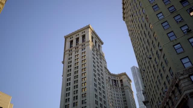 driving through cityscape skyscraper buildings in new york city