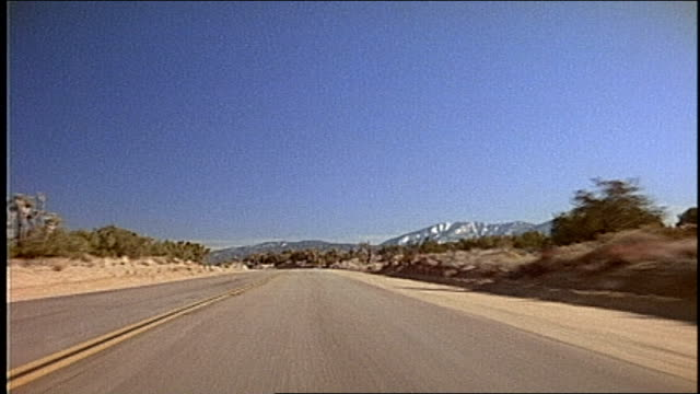 vidéos et rushes de of driving through desert in california - cactus
