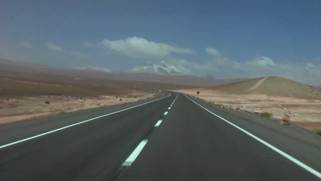 pov driving through desert landscape, san pedro de atacama, el loa, chile - san pedro de atacama stock videos & royalty-free footage