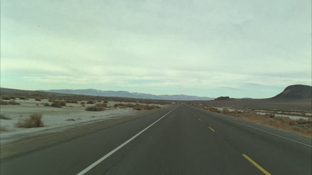 rear pov driving through desert on route 66 / nevada / arizona, usa - nevada stock videos & royalty-free footage