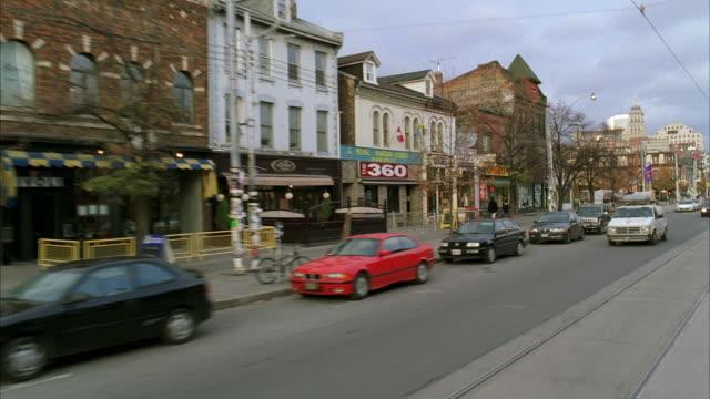 ws pov driving through downtown commercial area - butiksskylt bildbanksvideor och videomaterial från bakom kulisserna