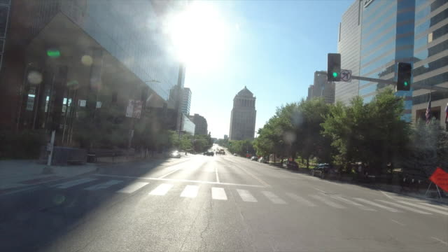 driving through downtown of st. louis, missouri, usa at sunset amid the 2020 global coronavirus pandemic - missouri stock videos & royalty-free footage