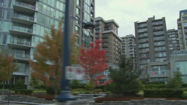 ws pov driving through downtown, office and apartment buildings / vancouver, british columbia, canada - vancouver stock-videos und b-roll-filmmaterial