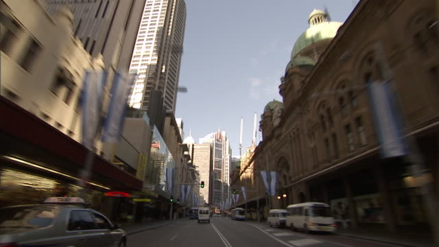 ws pov driving through downtown sydney toward tall building under construction / sydney, new south wales, australia  - point of view stock videos and b-roll footage