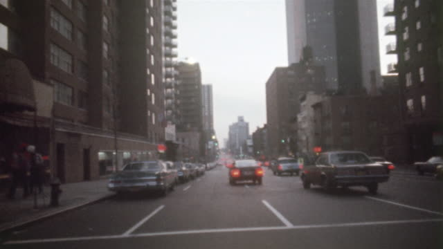 1978 MONTAGE POV Driving through downtown traffic, New York City, New York State, USA