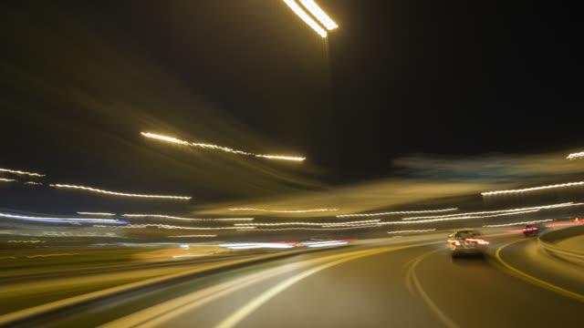 vídeos de stock e filmes b-roll de pov driving through dubai during night. - long exposure