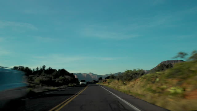 pov driving through forest and sedona - vanishing point stock videos & royalty-free footage