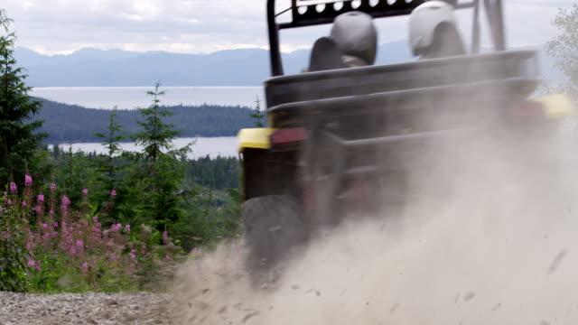 atv driving through gravel kicking up gravel - quadbike stock videos & royalty-free footage
