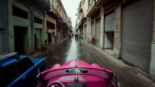 driving through havana, cuba, in a 1950's classic car - cuba video stock e b–roll