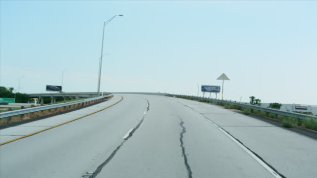 WS POV T/L Driving through Highway traffic in city / Dallas, Texas, USA