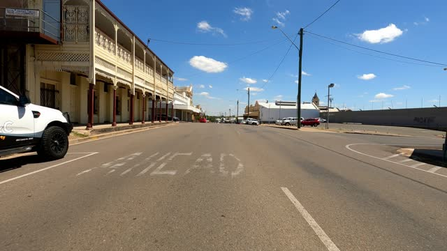 driving through historic country town on sunny day, rural australia - outback stock videos & royalty-free footage
