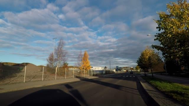 driving through industrial and residential area near port of helsinki, finland - finnland stock-videos und b-roll-filmmaterial