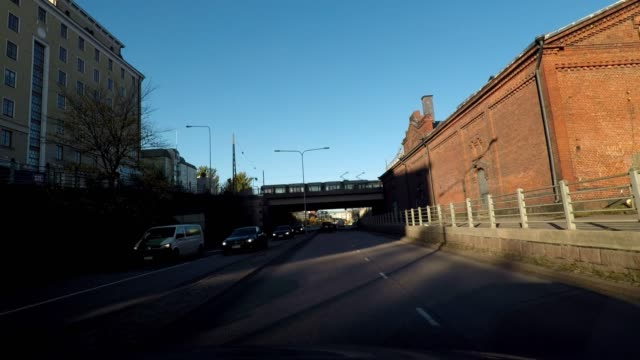 driving through industrial and residential area of helsinki, finland - geografische lage stock-videos und b-roll-filmmaterial