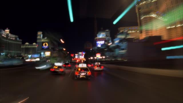 t/l, pov driving through las vegas strip at night, las vegas, nevada, usa  - eiffelturm nachbau stock-videos und b-roll-filmmaterial