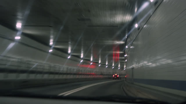 Driving POV through Lincoln Tunnel at night