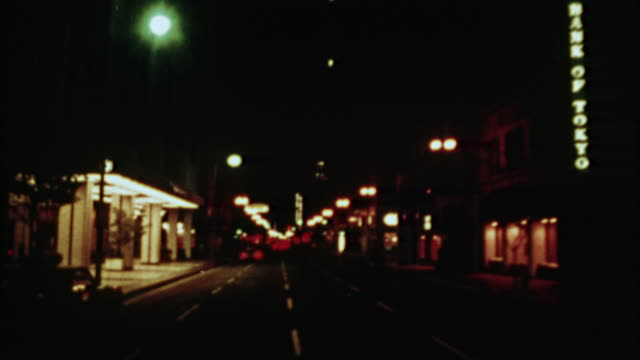 vídeos de stock, filmes e b-roll de pov, composite, driving through los angeles at night, 1970's, california, usa - 1973