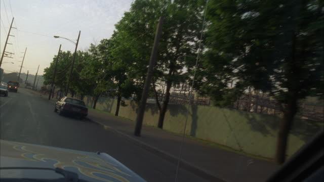 WS POV Driving through lower income neighborhood