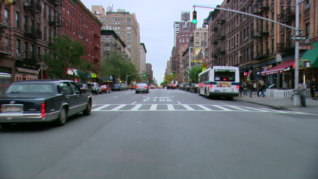 ts / front view / driving through manhattan / new york city, new york, united states - city street stock videos & royalty-free footage