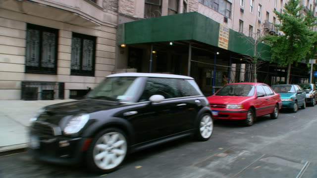 DS Driving through Midtown, cruising past town houses and parked vehicles / New York City, New York, United States