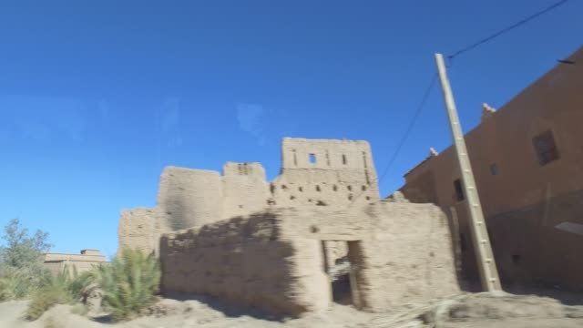 driving through morocco in christmas period - city viewing from cars window - pjphoto69 stock videos & royalty-free footage