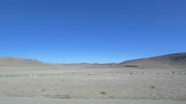 driving through morocco's mountains in christmas period - panorama viewing from car - pjphoto69 stock videos & royalty-free footage