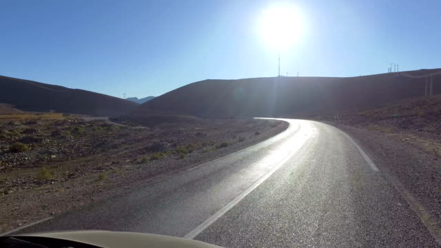 driving through morocco's mountains - panorama viewing from car like flying with a drone - pjphoto69 stock videos & royalty-free footage