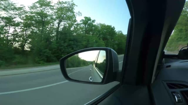 driving through of a small town - rear view mirror stock videos & royalty-free footage