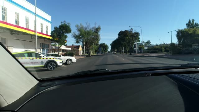 driving through outback town - car point of view stock videos & royalty-free footage