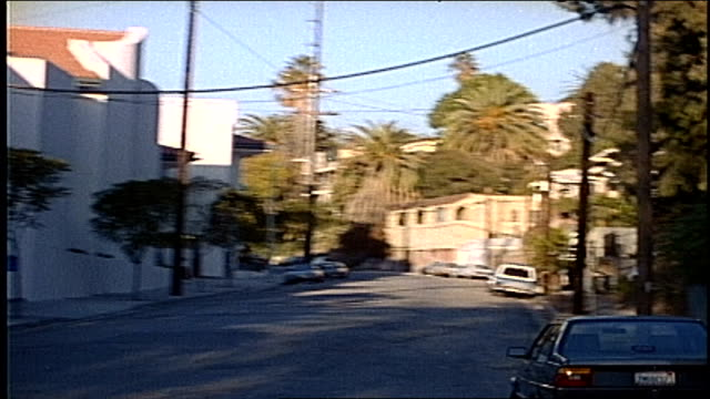 of driving through palm tree lined street in los angeles - anno 1995 video stock e b–roll
