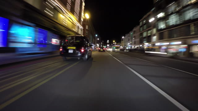 Driving POV through Piccadilly and Knightsbridge.