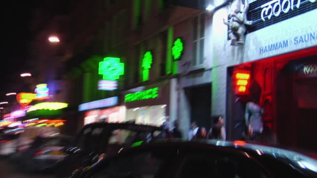 pov driving through pigalle neighborhood at night, paris, france - pornography stock videos & royalty-free footage