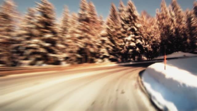 WS POV Driving through Poetschen Pass in winter / Austria