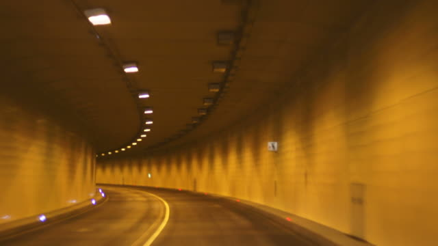POV T/L Driving Through Road Tunnel At Night