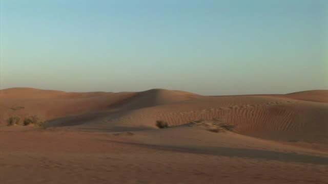 SIDE POV, Driving through sand dunes, Dubai, United Arab Emirates