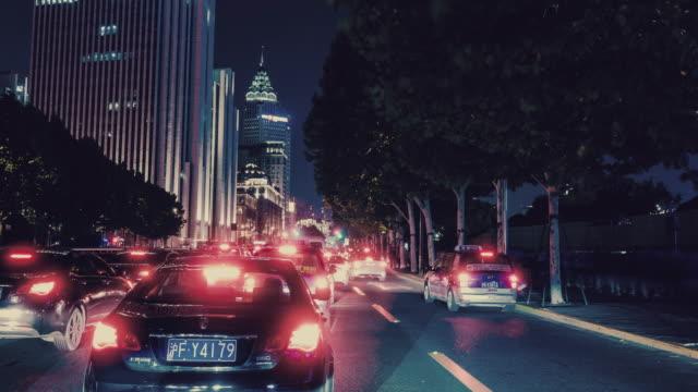 driving through shanghai city at night - time lapse - 車の視点点の映像素材/bロール