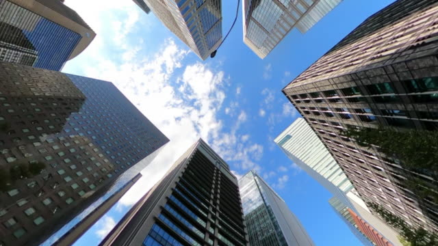 driving through skyscrapers in the city - inquadratura estrema dal basso video stock e b–roll
