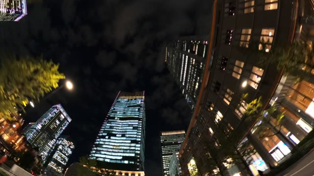 driving through skyscrapers in the night - low angle view stock videos & royalty-free footage