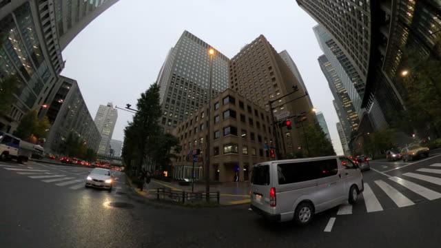 driving through skyscrapers / rainy day - plusphoto stock videos & royalty-free footage
