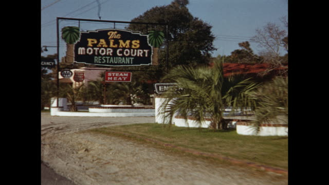 1954 pov driving through small town by motels and signs the palms motor court, ocean pines court, usa - wide shot stock videos & royalty-free footage